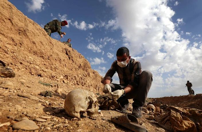 The remains of 141 people are to be identified after they were exhumed from mass graves uncovered in the northwestern Iraqi region of Sinjar, where the Yazidi minority was long based (AFP Photo/SAFIN HAMED)