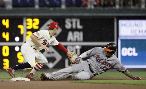 Baltimore Orioles' Manny Machado, right, slides into second base past Philadelphia Phillies second baseman Scott Kingery after Machado hit a double during the fourth inning of a baseball game, Tuesday, July 3, 2018, in Philadelphia. (AP Photo/Matt Slocum)