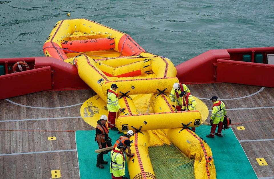 Members of the Maritime and Coastguard Agency deploy a giant inflatable counter-pollution kit named the Current Buster 6 (Andrew Matthews/PA) (PA Wire)