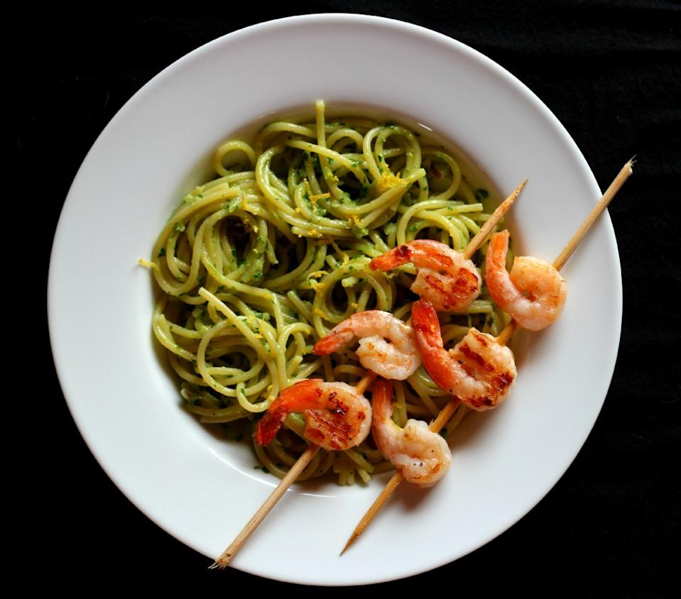 """Photo: Caffay Way<br> Pasta with Creamy Avocado Pesto and Grilled Shrimp<br><br> What happens when one brilliant blogger puts a smattering of some of our favorite ingredients on one single plate? Something like this.<br><br> Recipe: <a href=""""http://www.caffayway.com/2013/01/09/avocado-pasta/#"""" rel=""""nofollow noopener"""" target=""""_blank"""" data-ylk=""""slk:Pasta with Creamy Avocado Pesto and Grilled Shrimp"""" class=""""link rapid-noclick-resp"""">Pasta with Creamy Avocado Pesto and Grilled Shrimp</a>"""