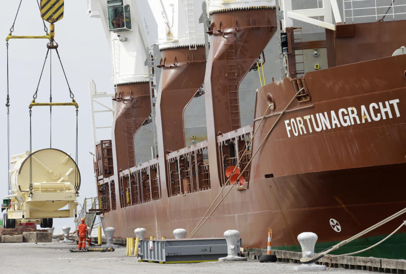 In this Monday, April 21, 2014 photo, the Amsterdam-bound Fortunagracht is loaded with road equipment to build highways, at the Port of Cleveland in Cleveland. The Commerce Department releases first-quarter gross domestic product on Wednesday, April 30, 2014. (AP Photo/Tony Dejak)