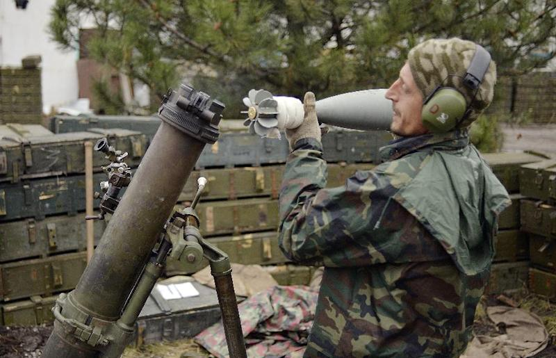 A Ukrainian serviceman loads a mortar in the village Peski near the town of Donetsk on October 18, 2014