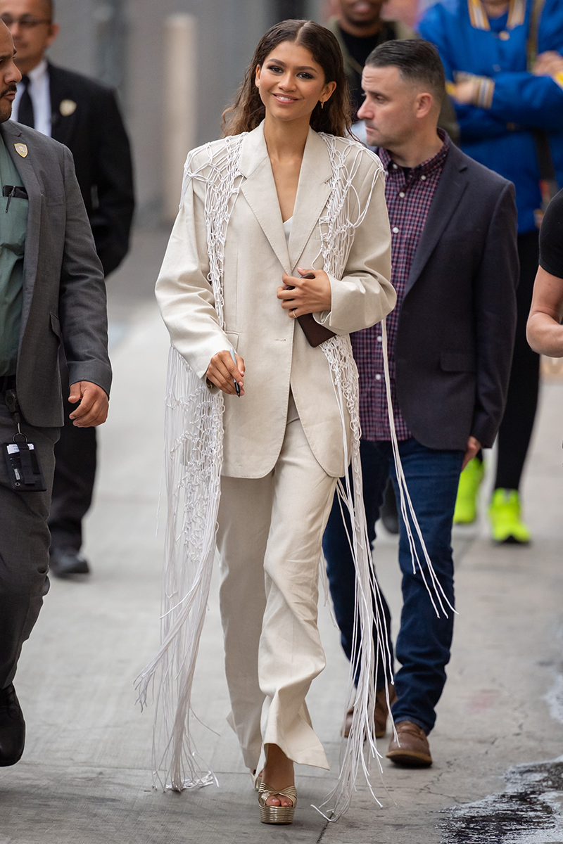 <p>We love a fun take on the classic trouser suit, demonstrated here by Zendaya, who's sporting a white netting shrug over the top of her ivory co-ord for an appearance on Jimmy Kimmel Live.<br></p>