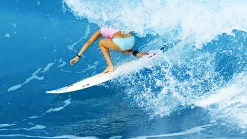 Carmen Greentree, pictured here surfing a wave.