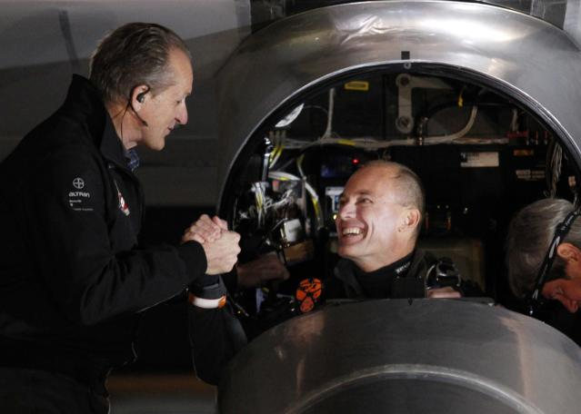 MOUNTAIN VIEW, CA - MAY 03: Pilot Bertrand Piccard (R) shakes hands with pilot Andre Borschberg before Piccard takes off in the Solar Impulse solar electric airplane at Moffett Field May 3, 2013 in Mountain View, California. Pilots Bertrand Piccard and Andre Borschberg are attempting the first cross-continental flight in a solar powered plane that can travel day and night. (Photo by Beck Diefenbach/Getty Images)