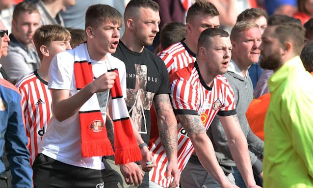 Sunderland fans shout at the linesman after a disallowed goal deep into injury time.