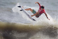 FILE - In this Sunday, Aug. 23, 2015, file photo, Kanoa Igarashi attempts a 360 air during his win in the Vans Pro Men's final at the 53rd annual Coastal Edge East Coast Surfing Championship in Virginia Beach, Va. It's a full-circle kind of Olympic connection for Kanoa Igarashi, the 23-year-old Californian with dual Japanese citizenship who is representing Japan. He's been surfing at the Olympic site, Tsurigasaki beach, his whole life and the location is deeply sentimental for his family. (L. Todd Spencer/The Virginian-Pilot via AP, File)