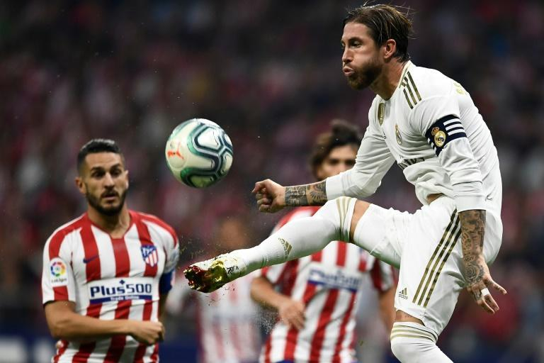 Sergio Ramos and Real Madrid drew 0-0 in the derby against Atletico and remain top of La Liga (AFP Photo/OSCAR DEL POZO)