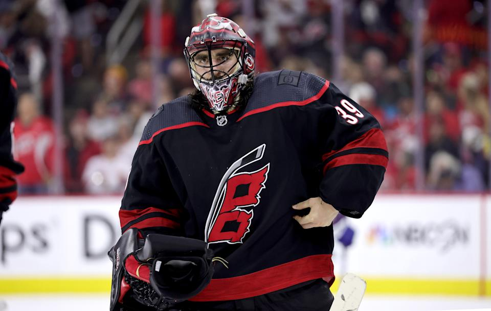 RALEIGH, NC - JUNE 8: Alex Nedeljkovic #39 of the Carolina Hurricanes returns to the crease to protect the net after a time out in Game Five of the Second Round of the 2021 Stanley Cup Playoffs against the Tampa Bay Lighting on June 8, 2021 at PNC Arena in Raleigh, North Carolina. (Photo by Gregg Forwerck/NHLI via Getty Images)