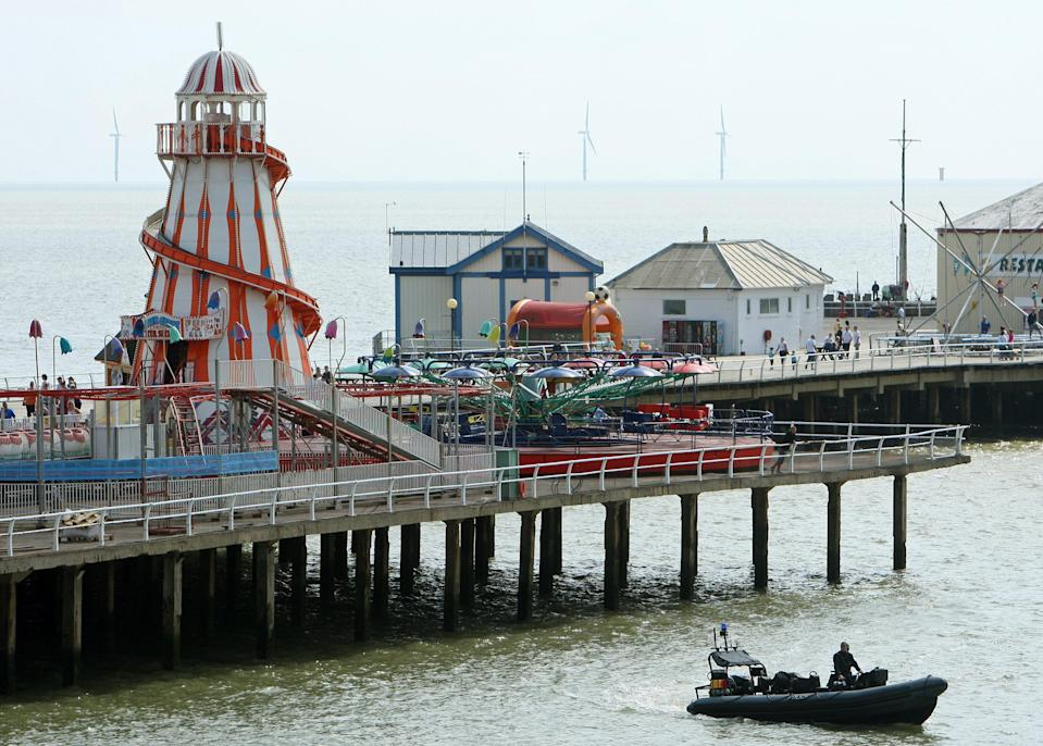 Police officers search the sea near the pier at Clacton on Sea, Essex, where police and rescue workers are continuing to search for a 10 year old girl who has been swept out to sea yesterday.