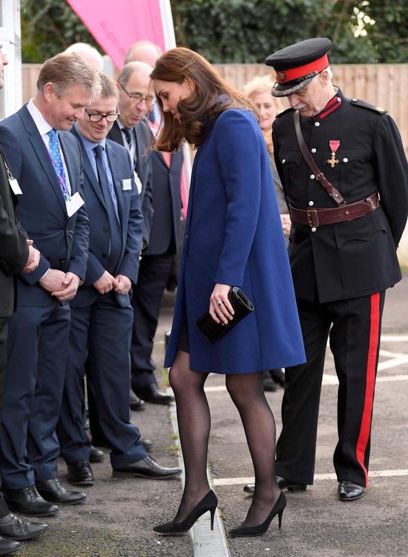 Kate's black heel becomes wedged in a grate in Essex. Photo: Getty