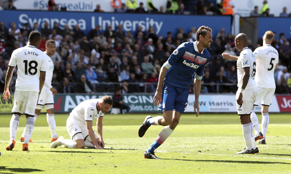 Stoke City's Peter Crouch, centre right, celebrates scoring his side's second goal of the game during the English Premier League soccer match between Swansea City and Stoke City, at the Liberty Stadium, in Swansea, Wales, Sunday May 13, 2018. (David Davies/PA via AP)