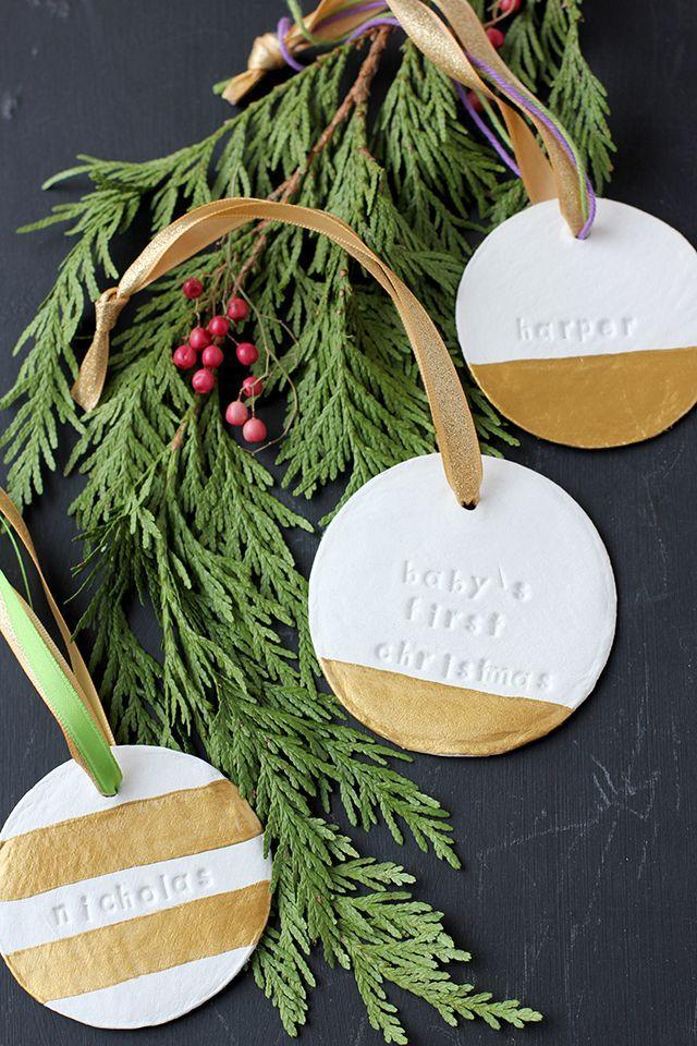 """<p>Though this blogger used her ornament to commemorate her <a href=""""https://www.countryliving.com/diy-crafts/a45699/babys-first-christmas-ornament-tutorial/"""" rel=""""nofollow noopener"""" target=""""_blank"""" data-ylk=""""slk:baby's &quot;first Christmas,&quot;"""" class=""""link rapid-noclick-resp"""">baby's """"first Christmas,""""</a> you can stamp these clay and gold-painted beauties with any message you like—or adorn them with names and give one to family members.</p><p><strong>Get the tutorial at <a href=""""https://projectnursery.com/2014/12/babys-first-christmas-ornament-diy/"""" rel=""""nofollow noopener"""" target=""""_blank"""" data-ylk=""""slk:Project Nursery"""" class=""""link rapid-noclick-resp"""">Project Nursery</a>.</strong></p><p><a class=""""link rapid-noclick-resp"""" href=""""https://www.amazon.com/Single-Color-Clay-50g-White/dp/B00FOQBAYA/?tag=syn-yahoo-20&ascsubtag=%5Bartid%7C10050.g.1070%5Bsrc%7Cyahoo-us"""" rel=""""nofollow noopener"""" target=""""_blank"""" data-ylk=""""slk:SHOP AIR DRY CLAY"""">SHOP AIR DRY CLAY</a></p>"""