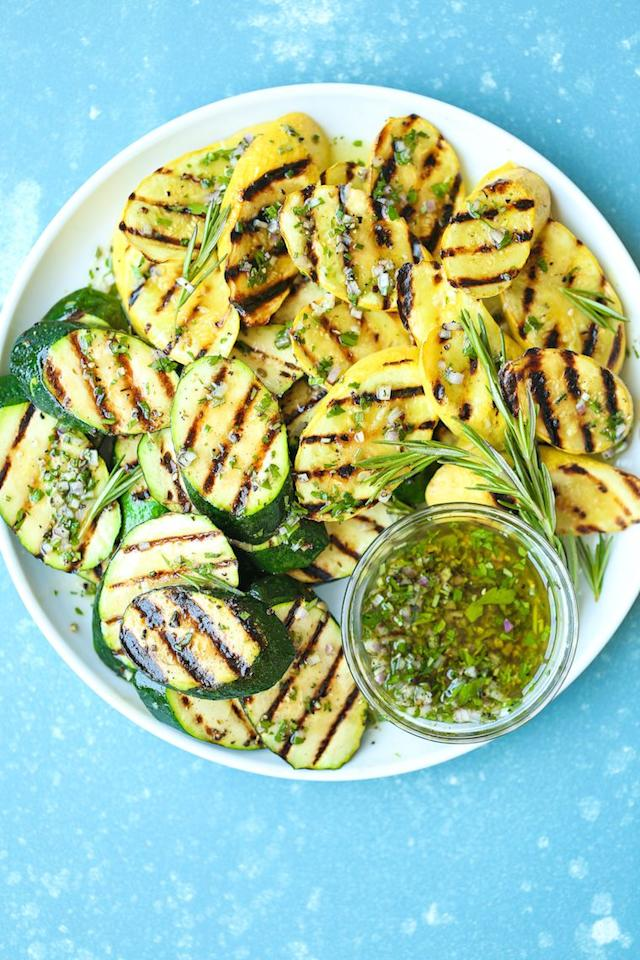 """<p>Yup, you can grill zucchini exactly the same way you might grill a hamburger! Those grill lines provide visual interest <em>and</em> a punch of smokey flavor.<em></em></p><p><strong>Get the recipe at <a href=""""https://damndelicious.net/2018/07/20/grilled-garlic-herb-zucchini/"""" target=""""_blank"""">Damn Delicious</a>.</strong></p><p><strong><a class=""""body-btn-link"""" href=""""https://www.amazon.com/Nordic-Ware-Natural-Aluminum-Commercial/dp/B0049C2S32?tag=syn-yahoo-20&ascsubtag=%5Bartid%7C10050.g.2524%5Bsrc%7Cyahoo-us"""" target=""""_blank"""">SHOP BAKING PANS</a><br></strong></p>"""