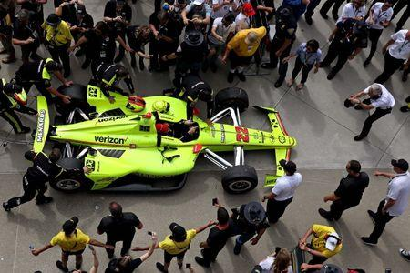May 26, 2019; Indianapolis, IN, USA; Indycar driver Simon Pagenaud (22) celebrates winning the 103rd Running of the Indianapolis 500 at Indianapolis Motor Speedway. Mandatory Credit: Peter Casey-USA TODAY Sports
