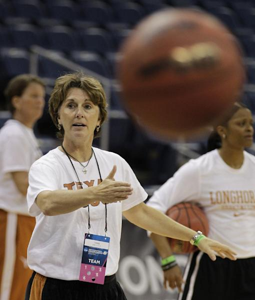 Texas head coach Gail Goestenkors directs her team during practice in Norfolk, Va., Friday, March 16, 2012. Texas plays West Virginia in an NCAA tournament first-round women's college basketball game on Saturday. (AP Photo/Steve Helber)