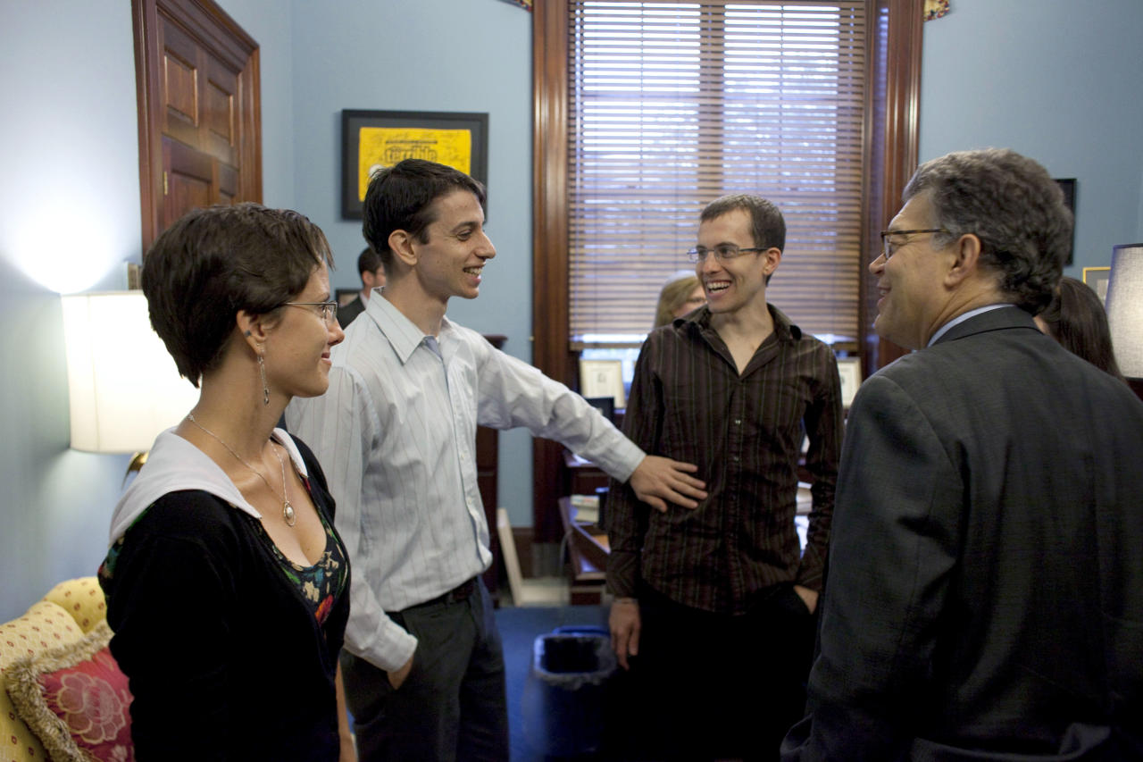 Sen. Al Franken, D-Minn., right, meets with US hikers who were imprisoned in Iran, from left, Sarah Shourd, Josh Fattal and Shane Bauer, Wednesday, Oct. 12, 2011, on Capitol Hill in Washington. (AP Photo/Harry Hamburg)