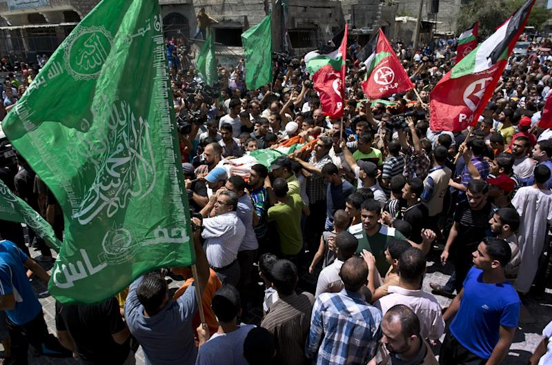 Relatives of 27-year-old Widad Deif, the wife of Hamas's military commander Mohammed Deif, carry her body during her funeral procession at the Jabaliya refugee camp in the northern Gaza Strip on August 20, 2014