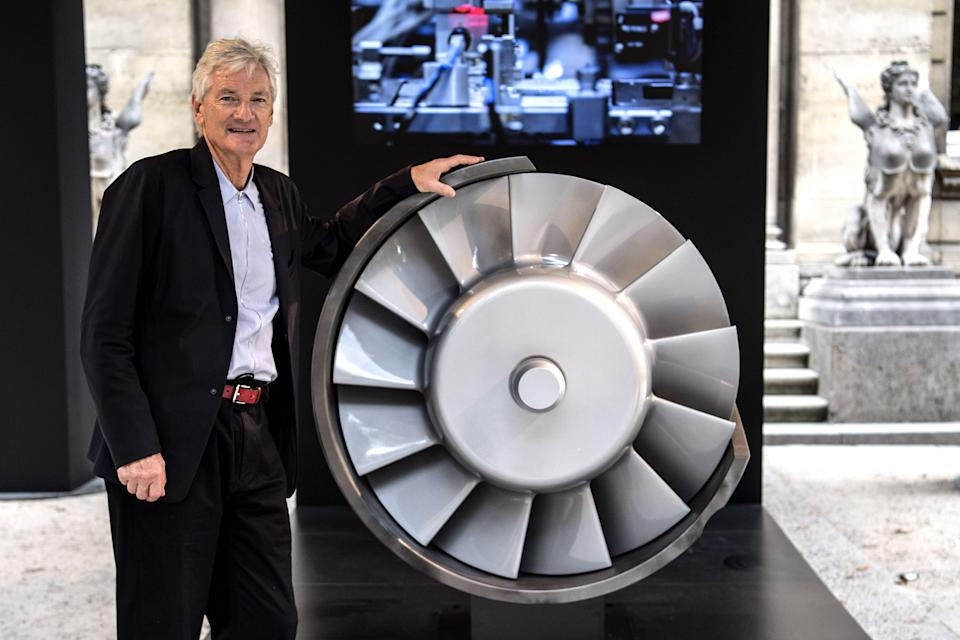 British industrial design engineer and founder of the Dyson company, James Dyson, poses next to the model of an engine during a photo session at a hotel in Paris on October 11, 2018. (Photo by Christophe ARCHAMBAULT / AFP)        (Photo credit should read CHRISTOPHE ARCHAMBAULT/AFP via Getty Images)