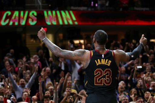 LeBron James of the Cleveland Cavaliers celebrates after hitting the game winning shot to beat the Toronto Raptors 105-103 in game three