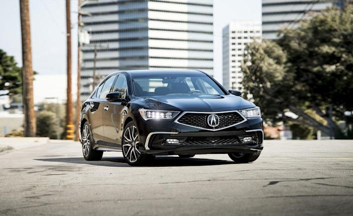 """<p>Officially, <a href=""""https://www.caranddriver.com/acura/rlx"""" rel=""""nofollow noopener"""" target=""""_blank"""" data-ylk=""""slk:the Acura RLX hybrid"""" class=""""link rapid-noclick-resp"""">the Acura RLX hybrid</a> is called <a href=""""https://www.caranddriver.com/reviews/a15076267/2018-acura-rlx-sport-hybrid-sh-awd-first-drive-review/"""" rel=""""nofollow noopener"""" target=""""_blank"""" data-ylk=""""slk:the Acura RLX Sport Hybrid"""" class=""""link rapid-noclick-resp"""">the Acura RLX Sport Hybrid</a>, with the sport part of the name hinting that the sedan prioritizes performance over efficiency. That it does: There is a V-6 engine and three electric motors, one to aid the engine directly in powering the front axle and another two that work in concert to spin the rear wheels. The result is a luxurious hybrid sedan with some athletic moves and slightly better mileage than its gas-only counterpart (28 mpg vs. 23 mpg).<br></p>"""