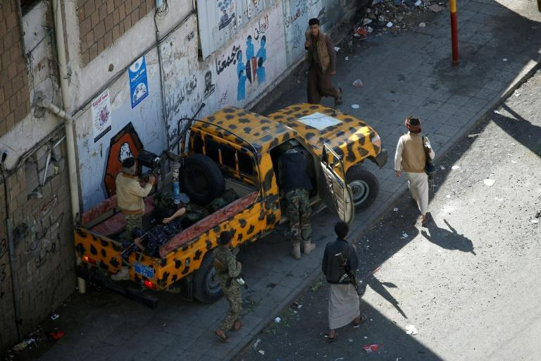 Huthi fighters patrol a street in the Yemeni capital Sanaa on December 3, 2017, during clashes with supporters of Yemeni ex-president Ali Abdullah Saleh