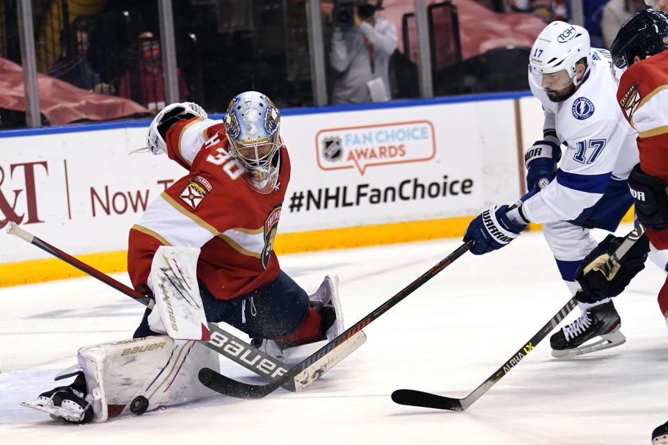 FILE - In this May 24, 2021, file photo, Florida Panthers goaltender Spencer Knight (30) stops a shot on the goal by Tampa Bay Lightning left wing Alex Killorn (17) during the first period in Game 5 of an NHL hockey Stanley Cup first-round playoff series in Sunrise, Fla. Knight went from playing in college to making an impact on his team at the most important time of the year. (AP Photo/Lynne Sladky, File)