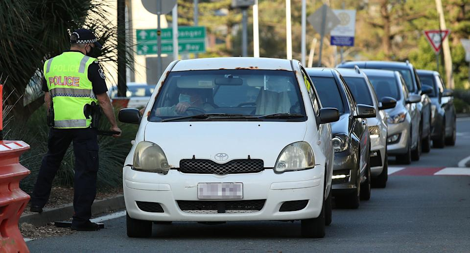 Police check cars at the QLD/NSW border, Gold Coast, Thursday, September 2, 2021. Source: AAP