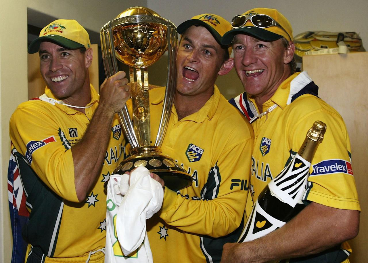 JOHANNESBURG - MARCH 23:  Michael Bevan, Adam Gilchrist and Andy Bichel of Australia celebrate with the trophy and champagne in the rooms after the World Cup Final One Day International Match between Australia and India played at the Wanderers, Johannesburg, South Africa on March 23, 2003. Australia defeated India by 125 runs to win the World Cup. (Photo by Hamish Blair/Getty Images)