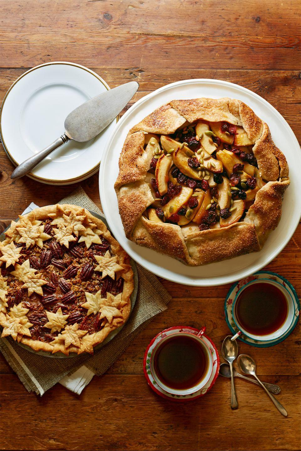 "<p>Spread fall cheer by delivering a freshly baked dessert to a neighbor in need.</p><p><strong>Get the recipes for </strong><a href=""https://www.countryliving.com/food-drinks/recipes/a5863/granola-pecan-pie-recipe-clx1114/"" rel=""nofollow noopener"" target=""_blank"" data-ylk=""slk:Maple Granola Pecan Pie"" class=""link rapid-noclick-resp""><strong>Maple Granola Pecan Pie</strong></a><em> <strong>(left) </strong></em><strong>and</strong> <strong><a href=""https://www.countryliving.com/food-drinks/recipes/a5859/apples-crostata-recipe-clx1114/"" rel=""nofollow noopener"" target=""_blank"" data-ylk=""slk:Apple Crostata"" class=""link rapid-noclick-resp"">Apple Crostata</a>.</strong></p>"