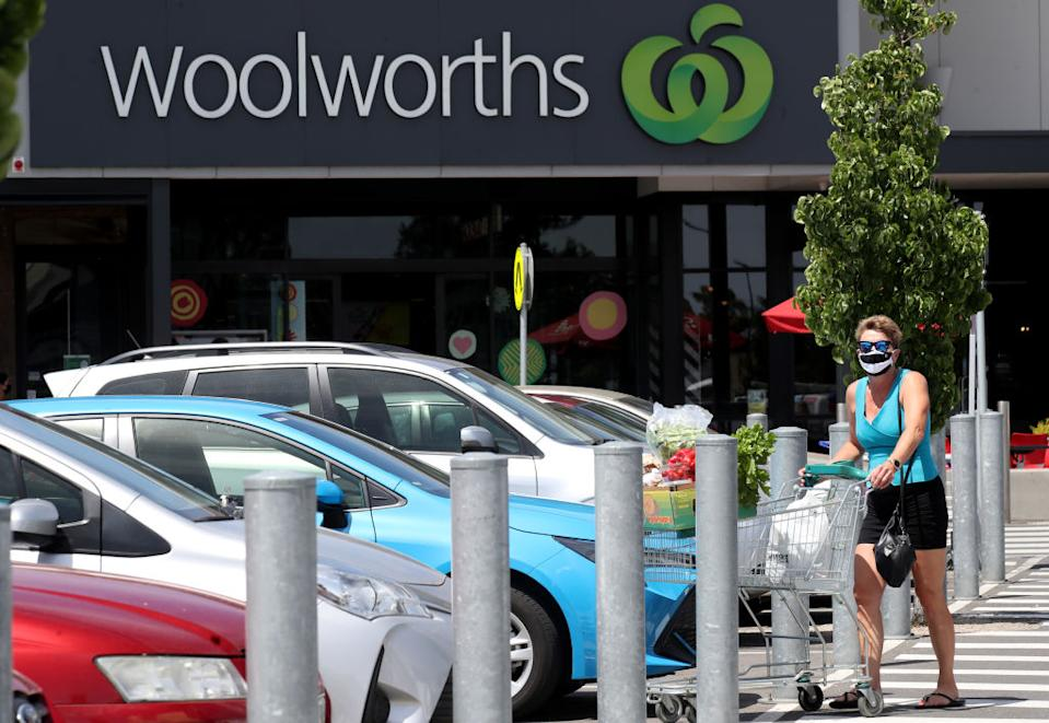 A lady in a mask leaves Woolworths at West Torrens in Adelaide, Australia.