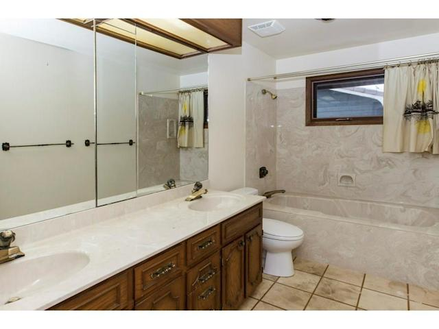 <p><span>119 Pump Hill Rd. Southwest, Calgary, Alta.</span><br> There are also two-and-a-half bathrooms, plus a rough-in for an additional bathroom in the walk-out basement.<br> (Photo: Zoocasa) </p>