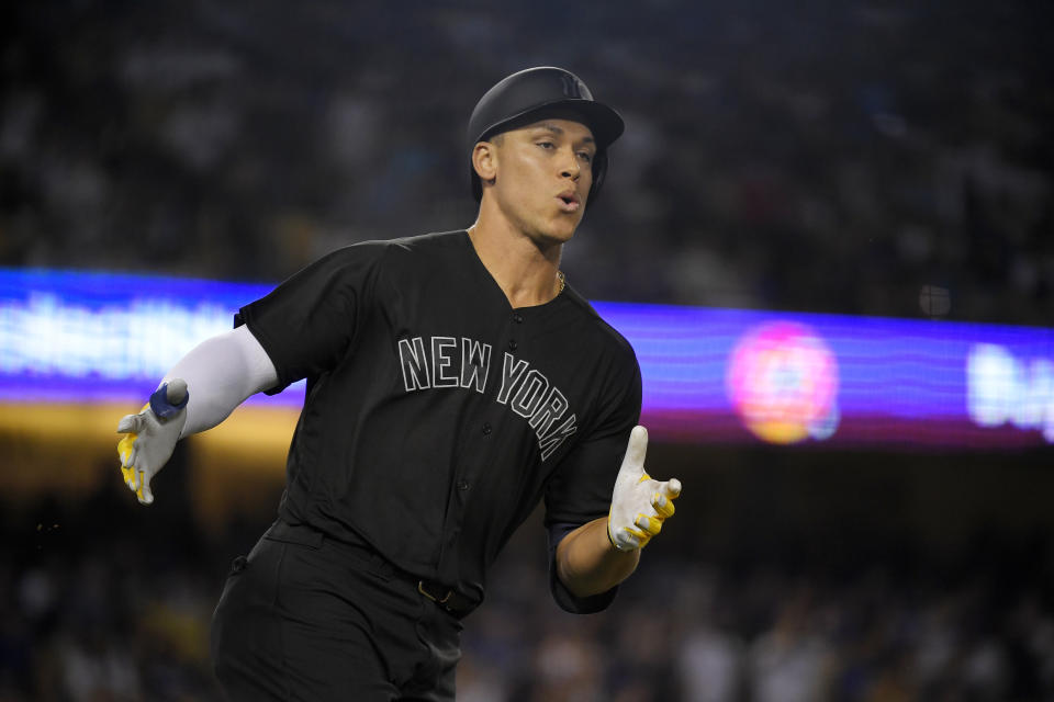 New York Yankees' Aaron Judge rounds first after hitting a solo home run during the third inning of a baseball game against the Los Angeles Dodgers Friday, Aug. 23, 2019, in Los Angeles. (AP Photo/Mark J. Terrill)