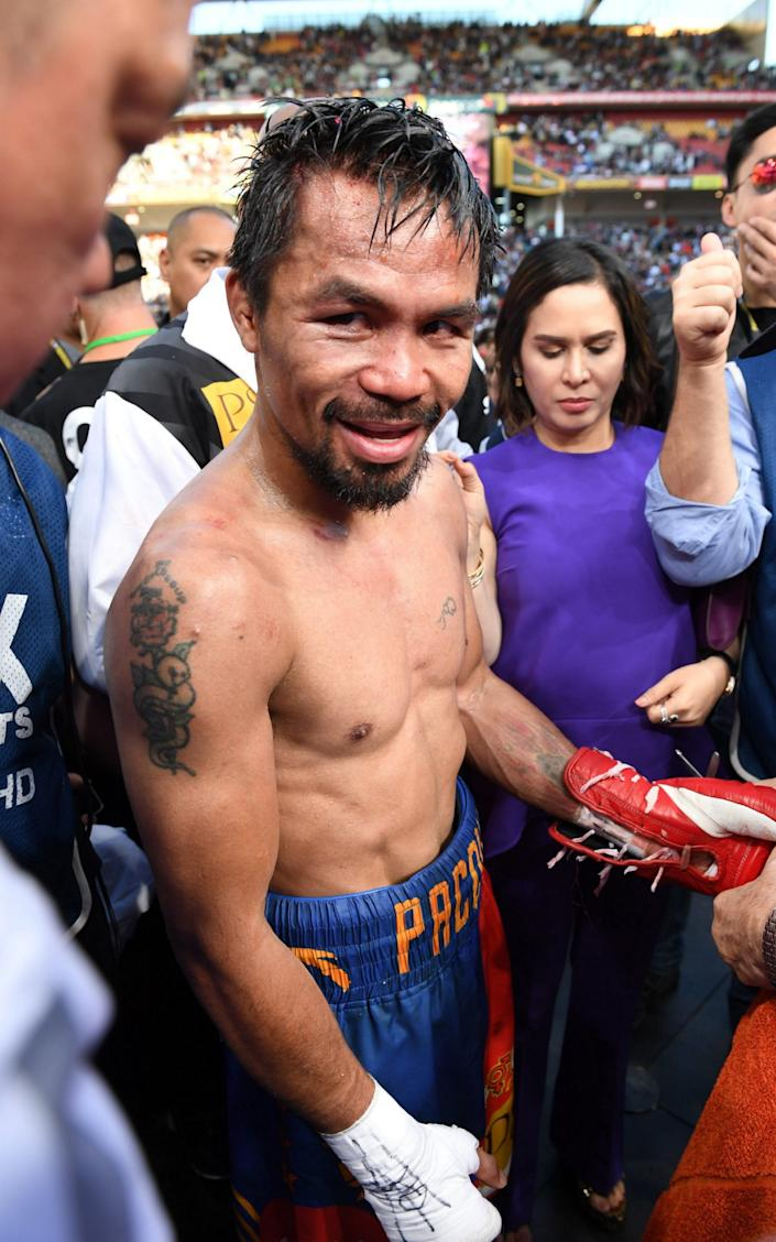 """A """"huge portion"""" of Pacquiao's earnings would go to those who were affected by the pandemic, the fighter's team said - Dave Hunt/AAP"""