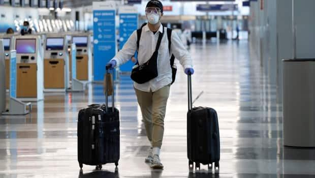 By early July, vaccinated travellers entering Canada will be able to skip the 14-day quarantine requirement, including the mandated hotel stay for air travellers. (Nam Y. Huh/The Associated Press - image credit)