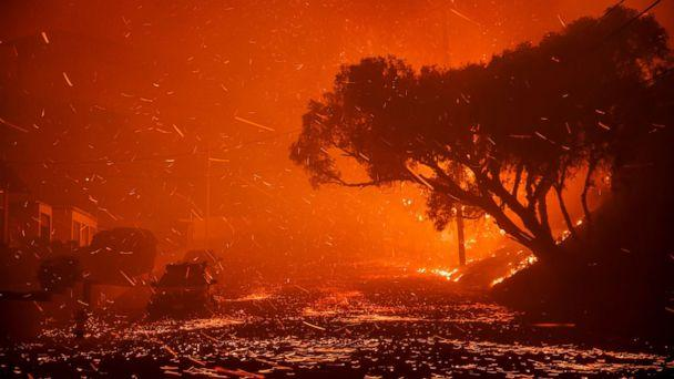 PHOTO: A brush fire moving with the wind sends embers all over the place in residential neighborhoods north of Ventura, destroying homes and forcing 27,000 people to evacuate. (Marcus Yam/Los Angeles Times/Polaris)