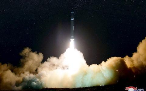 <span>North Korean launching of the Hwasong-15 missile which is capable of reaching all parts of the US in November 2017</span> <span>Credit: AFP/ KCNA VIA KNS </span>