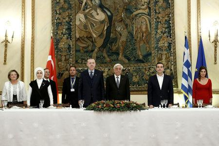Greek Prime Minister Alexis Tsipras, his partner Peristera Baziana, Greek President Prokopis Pavlopoulos, Turkish President Tayyip Erdogan and his wife Emine Erdogan attend a state dinner at the Presidential Palace in Athens, Greece, December 7, 2017. REUTERS/Costas Baltas