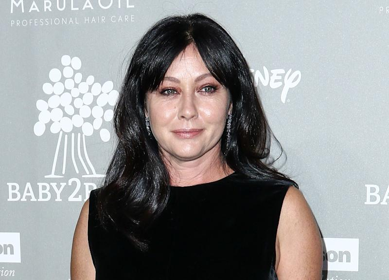 FILE - In this Nov. 14, 2015 file photo, Shannen Doherty attends the 4th Annual Baby2Baby Gala in Culver City, Calif. Court records show Doherty has reached a conditional settlement with her former business managers in a lawsuit in which she accused them of mismanaging her money and causing a lapse in her health insurance that led to a delay in her being diagnosed with breast cancer. The settlement notice filed Friday, Aug. 19, 2016, in Los Angeles states certain undisclosed settlement terms must happen within 45 days. (Photo by John Salangsang/Invision/AP, File)