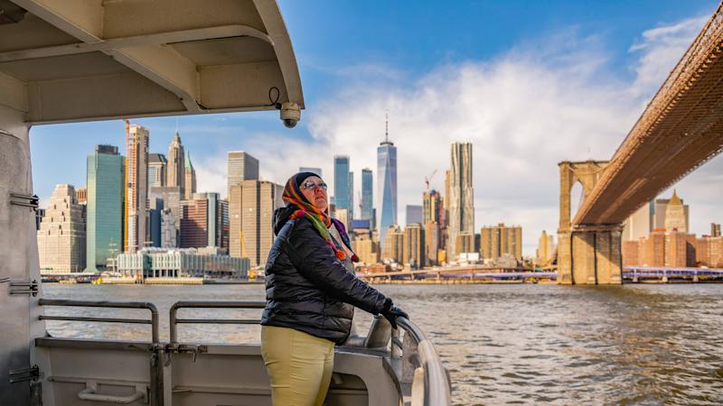 mature middle aged woman riding ferry in New York City