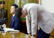 FILE PHOTO: Otto Frederick Warmbier (R), a University of Virginia student who has been detained in North Korea since early January, bows during a news conference in Pyongyang, North Korea, in this photo released by Kyodo February 29, 2016. Mandatory credit REUTERS/Kyodo/File Photo