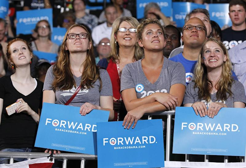 People watch a video of President Barack Obama during a campaign rally at The Ohio State University, Saturday, May 5, 2012 in Columbus, Ohio . (AP Photo/Haraz N. Ghanbari)