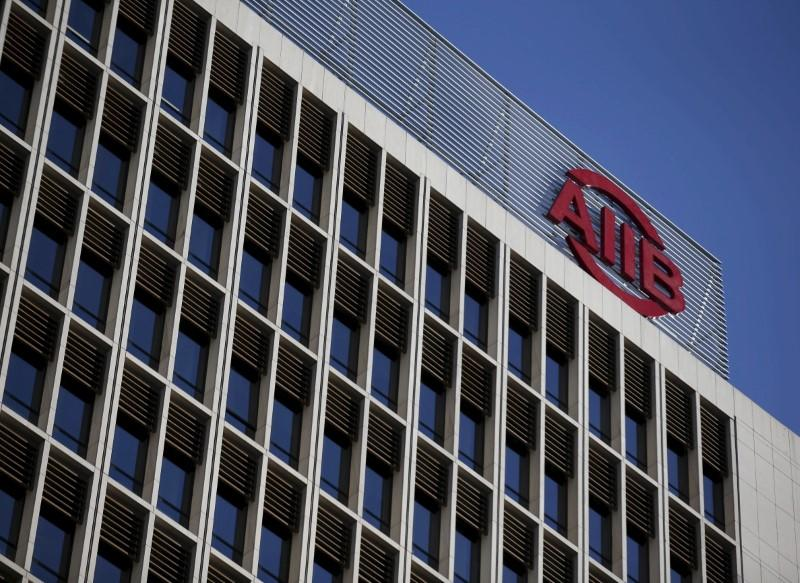 The logo of Asian Infrastructure Investment Bank (AIIB) is seen at its headquarter building in Beijing