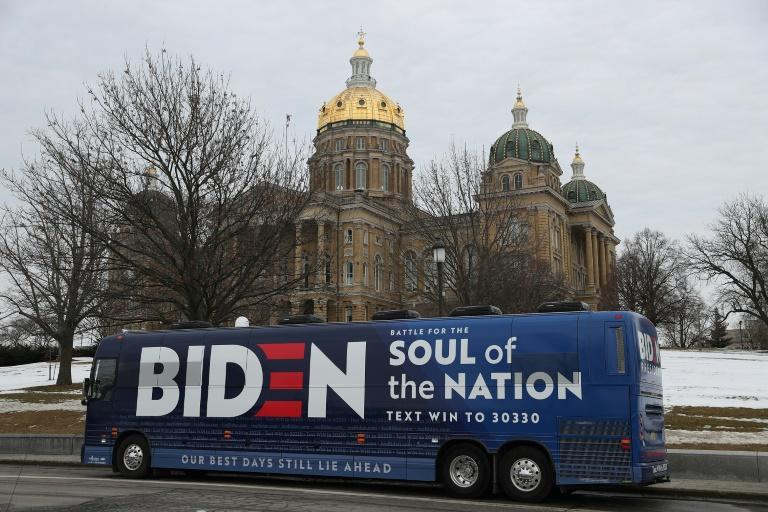 Video posted on Twitter appears to show multiple trucks waving Donald Trump flags surrounding and slowing a Biden/Harris bus (similar to this one pictured February 2020) on a Texas highway