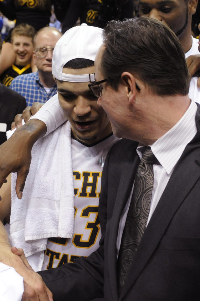 Wichita State coach Gregg Marshall, right, celebrates with Fred VanVleet, left, after their victory over Indiana State in an NCAA college basketball game for the championship of the Missouri Valley Conference, Sunday, March 9, 2014, in St. Louis. (AP Photo/Bill Boyce)