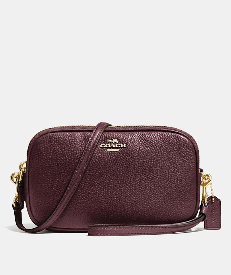 """<p>Small yet roomy enough for traveling or a night out, this crossbody is a must-have addition to your handbag collection. With its silky-soft pebble leather and plenty of interior pockets to store your wallet, phone, and other daily essentials, this bag is ready to be a staple in your closet. </p> <p><strong>To buy: </strong>$105 (was $175); <a href=""""https://click.linksynergy.com/deeplink?id=93xLBvPhAeE&mid=37299&murl=http%3A%2F%2Fwww.coach.com%2Fcoach-sadie-crossbody-clutch%2F65547.html&u1=RS%2C7BagsWe%25E2%2580%2599reObsessedWithFromCoach%25E2%2580%2599sInsane50%2525OffCyberMondaySale%2Cmalcedo805%2CHAN%2CIMA%2C657689%2C201912%2CI"""" target=""""_blank"""">coach.com</a>.</p>"""