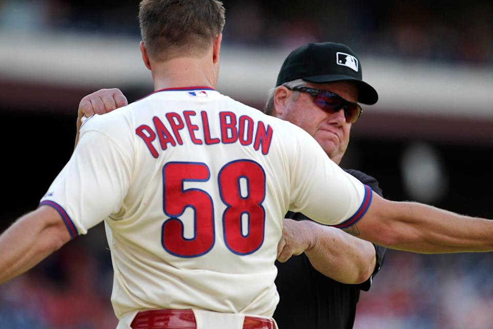 Joe West grabs Jonathan Papelbon after ejecting the Phillies pitcher from a game in 2014.