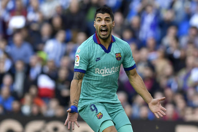 Barcelona's Luis Suarez gestures during the Spanish La Liga soccer match between Real Sociedad and Barcelona, at Anoeta stadium, in San Sebastian, Spain, Saturday, Dec. 14, 2019. (AP Photo/Alvaro Barrientos)