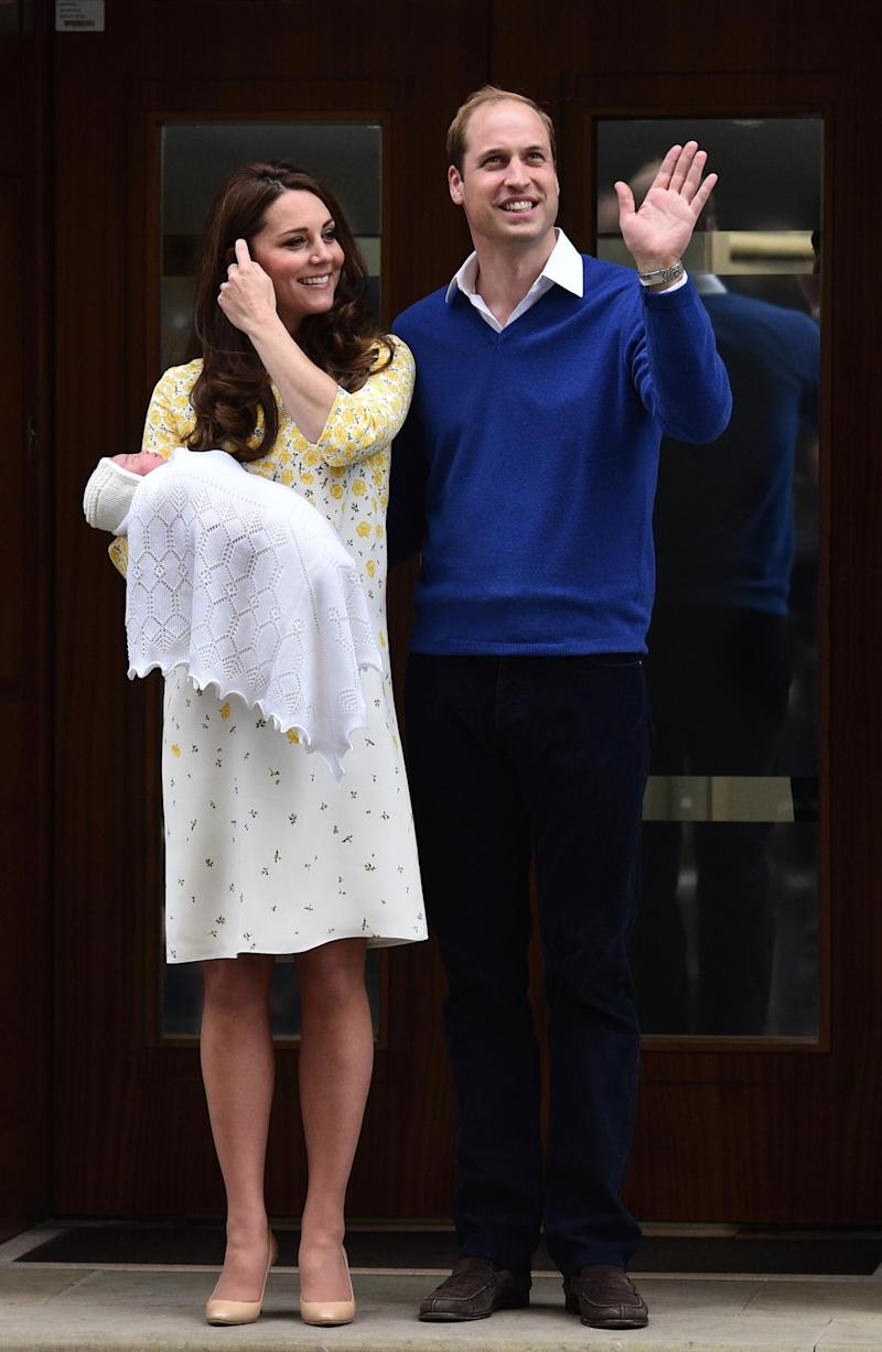Kate and William pose with Princess Charlotte (AFP/Getty Images)