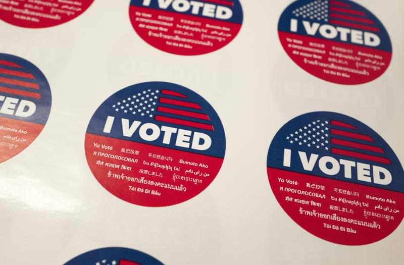 """FILE - In this Tuesday, June 5, 2018, file photo, """"I Voted"""" stickers wait for voters at a polling station inside the library at Robert F. Kennedy Elementary School in Los Angeles. Californians start voting Monday, Feb. 3, 2020, in a high-profile Democratic presidential primary that has no clear front-runner. The March 3 primary was moved up from its usual June date so Californians might have more of a say in the outcome of the primary and the decision about the eventual Democratic nominee. (AP Photo/Richard Vogel, File)"""